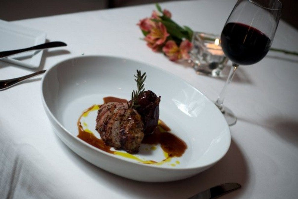 Dish on a plate with a glass of wine
