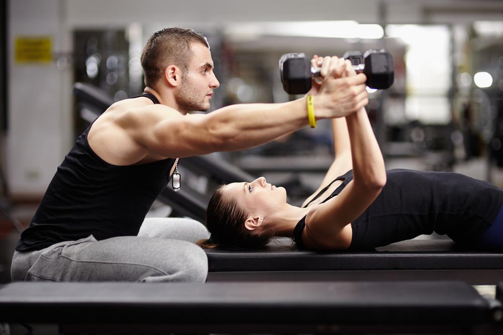 men helping girl in gym